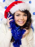 Happy woman celebrating Christmas in a Santa hat