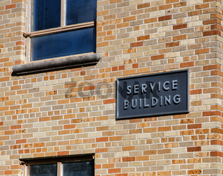 Service Building Marked with Sign