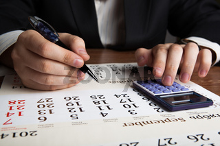 man calculates future plans