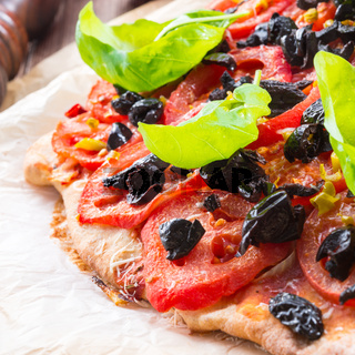 homemade olive - tomato pizza