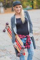 Cool Pretty Woman Holding Skateboard