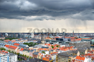The bird's eye view from the Church of Our Saviour with the rain over Copenhagen.