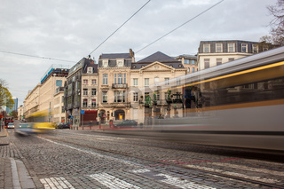 Tramway in motion on the street of Brussels near The Sablon Square