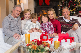 Multi generation family smiling at camera during christmas
