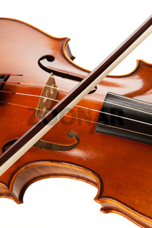 Violin with bow in front of white background
