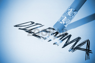 Pencil erasing the word Dilemma