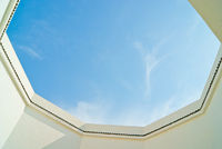 Blue-sky-viewed-from-an-arabic-courtyard-shot-from-below-upwards