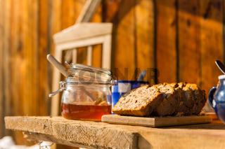 Winter breakfast outside wooden cottage