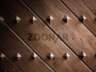 Diamond shaped metal studs on a door