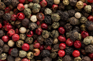 small dry colored peppercorn in food background