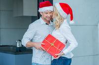 Woman kissing her husband on Christmas Day