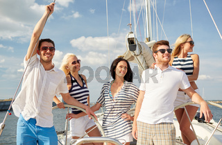 smiling friends sailing on yacht