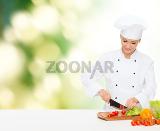 smiling female chef chopping vagetables