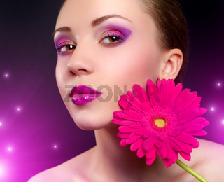 Girl with gerbera flower