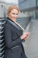 Stylish businesswoman using a tablet-pc