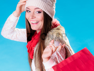 Winter woman with red paper shopping bag