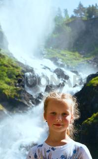 Portrait girl on summer waterfall background