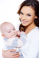 Pretty Young Mom Carrying Smiling Cute Baby