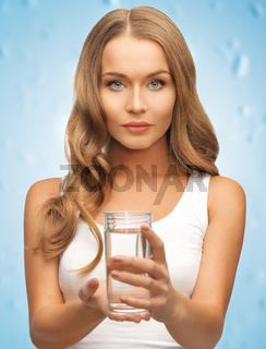 woman hands holding glass of water