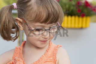 Little girl looks down shyly