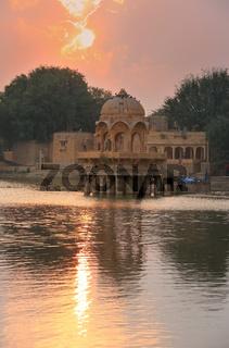 Gadi Sagar temple on Gadisar lake at sunset, Jaisalmer, India