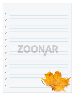 Notebook paper with autumn dry maple leaf on white