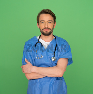 Confident friendly young male doctor or nurse