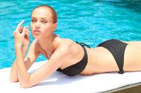 Gorgeous Woman in Bikini Lying at Poolside
