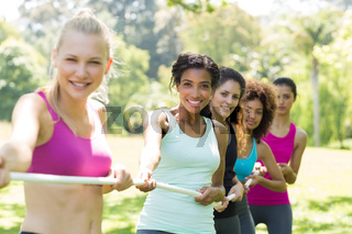 Women pulling a rope in tug of war