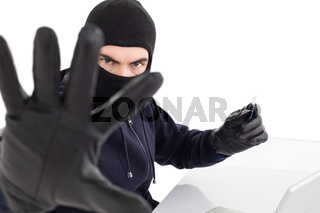 Angry hacker using credit card and gesturing