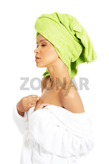 Attractive woman wrapped in towel with turban.