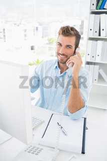 Portrait of a male photo editor using phone