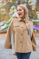 Happy Braided Hair Woman in Autumn Outfit