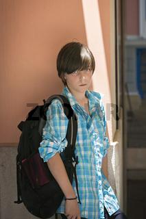 teen boy with rucksack on travel