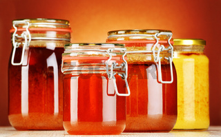 Composition with jars of honey.