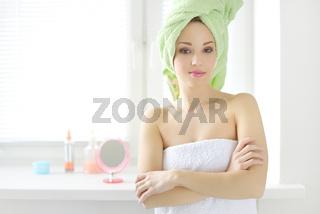 beautiful girl standing in towel