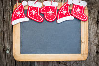 Christmas tree decorations border on vintage wooden blackboard