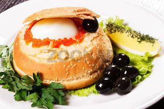Roll with caviar, olives and egg