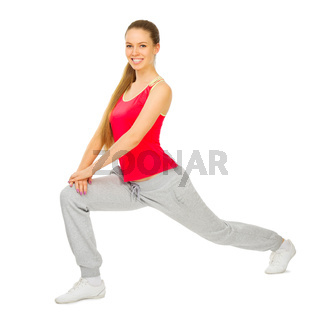 Young sporty girl doing gymnastic exercises isolated