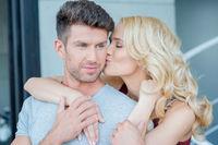 Loving woman kissing her husband or boyfriend
