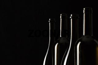 Silhouettes of elegant wine bottles