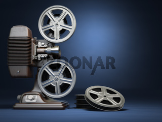 Video, cinema concept. Vintage film movie projector and reels on blue background.