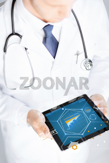close up of doctor with stethoscope and tablet pc
