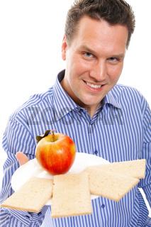 Healthy lifestyle man eating crispbread and apple