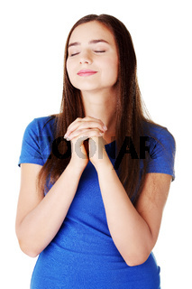 Young beautiful woman is praying.