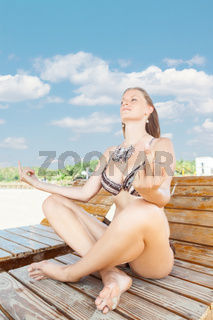 Woman relaxing in tropical resort