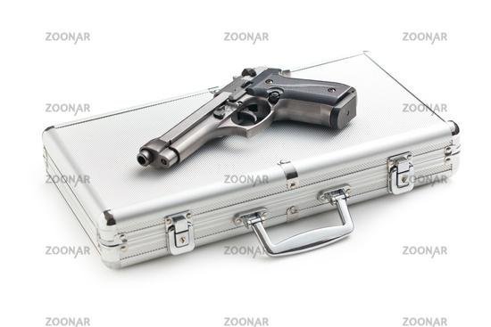 handgun on aluminium case