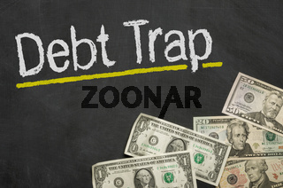 Text on blackboard with money - Debt Trap
