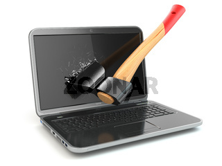 Laptop damaged by axe. Concept of anger when working at the computer or in internet.