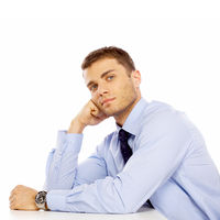 Sitting Young Salesman with Hand on Face